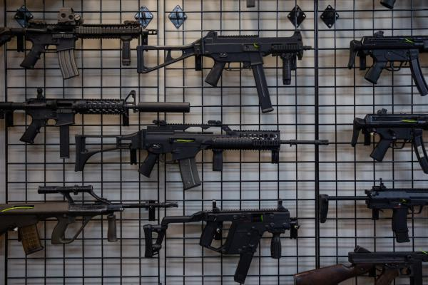 An assortment of rifles sits on racks at Delta Arsenal, a gun shop in Wallingford, Connecticut.