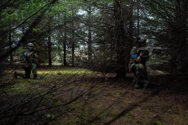<p>Noah Wenger and Andrew Pollmann play AirSoft at Action Acres AirSoft on March 23, 2019, in Canby, Ore.</p>