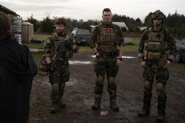 <p>Noah Wenger, Andrew Pollmann, and Alex Bates listen to the rules before playing an AirSoft game at Action Acres AirSoft on March 23, 2019, in Canby, Ore.</p>