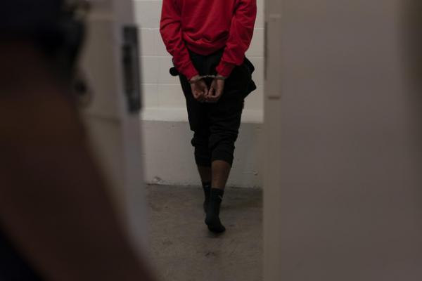 <p>A manwalks into a Multnomah County Jail cell after being arrested on Friday, Sept. 21, 2018 in Portland, Ore.</p>