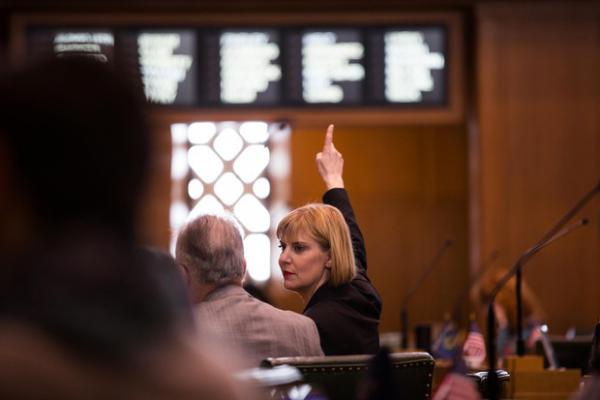 <p>House Majority Leader Jennifer Williamson, D-Portland, signals her vote on the House floor at the Capitol in Salem, Ore., Tuesday, April 2, 2019.</p>