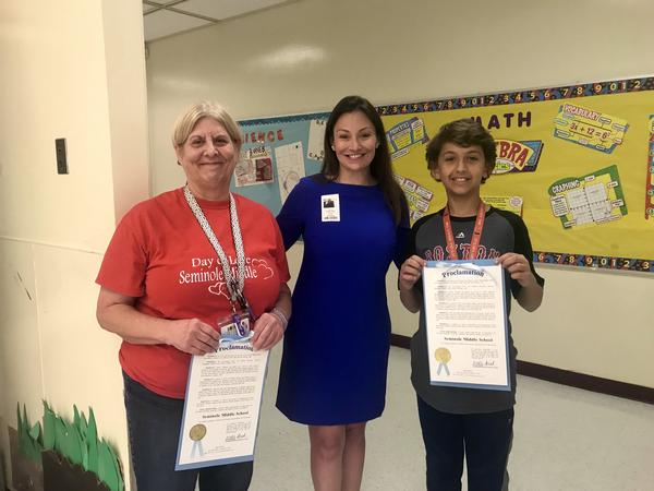 Agriculture Commissioner Nikki Fried, center, presented a proclamation to Seminole Middle School Wednesday. She stands with teacher Susan Fried, left, and seventh-grader Ben Polsky, right.