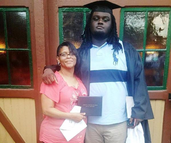 Garden City Community College trustees have approved an independent investigation into the death of football player Braeden Bradforth, pictured at his high school graduation with his mother.