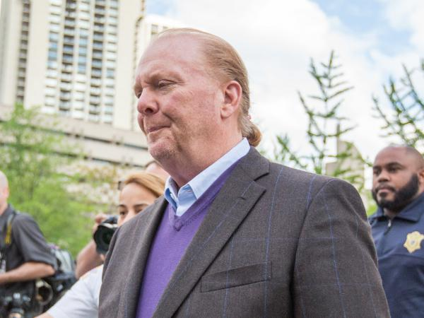 Celebrity chef Mario Batali leaves Boston Municipal Court on Friday following a court appearance on a charge of indecent assault and battery in connection with a 2017 incident at a restaurant of his in Boston.
