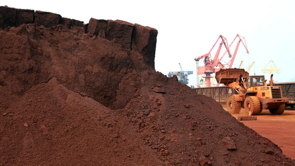 """A worker in China shifts soil containing rare earth minerals intended for export in 2010. Rare earths are used in important technologies, and a <a href=""""http://en.people.cn/n3/2019/0529/c90000-9582572.html"""">commentary in China's People's Daily newspaper</a> on Wednesday said the U.S. endangers its supply from China by waging a trade war."""