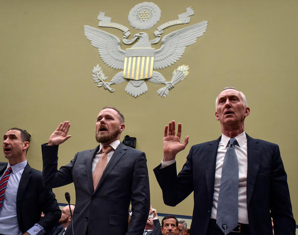 During testimony before a congressional hearing on drug prices this month, Dr. Aaron Lord (left), a patient advocate and AIDS activist, publicly challenged Daniel O'Day, CEO of Gilead Sciences (right), to lower the price of Gilead's HIV prevention drug Truvada.