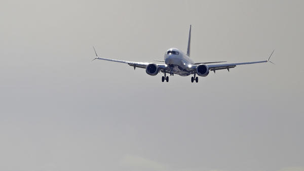 A Boeing 737 Max operated by Air Canada comes in for a landing on March 27, 2019 at Boeing Field in Seattle. In addition to problems detected with the 737 Max, the FAA says there is a new issue with some 737s: they may have faulty parts on their wings.