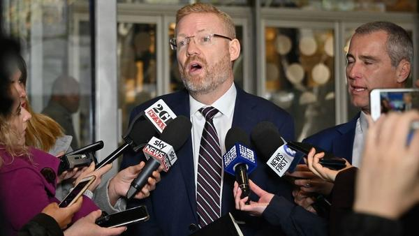 ABC editorial director Craig McMurtrie speaks to the media as Australian police raided the headquarters of the Australian Broadcasting Corp. in Sydney on Wednesday. ABC executives said police executed a search warrant targeting three journalists involved in a two-year investigative report.