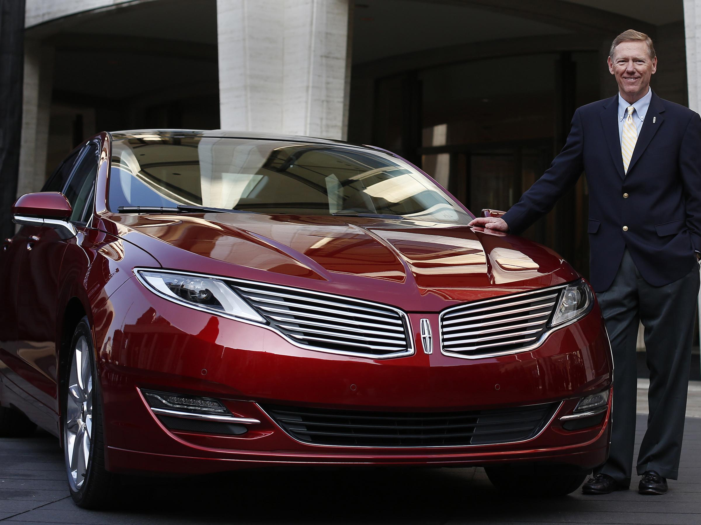 Detroit three look to revive their luxury brands kuow for Ford motor company executives