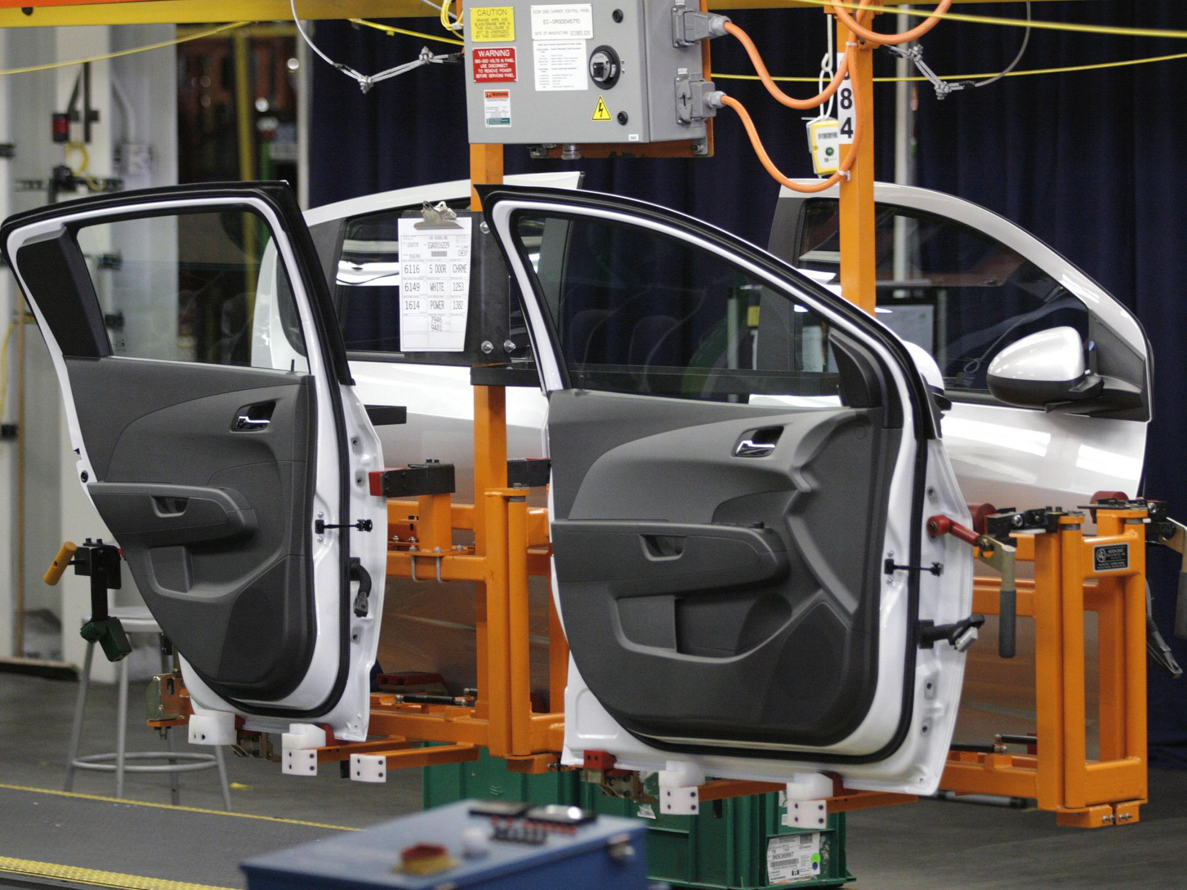 Economy expanding at moderate rate fed says kera news for General motors assembly plant