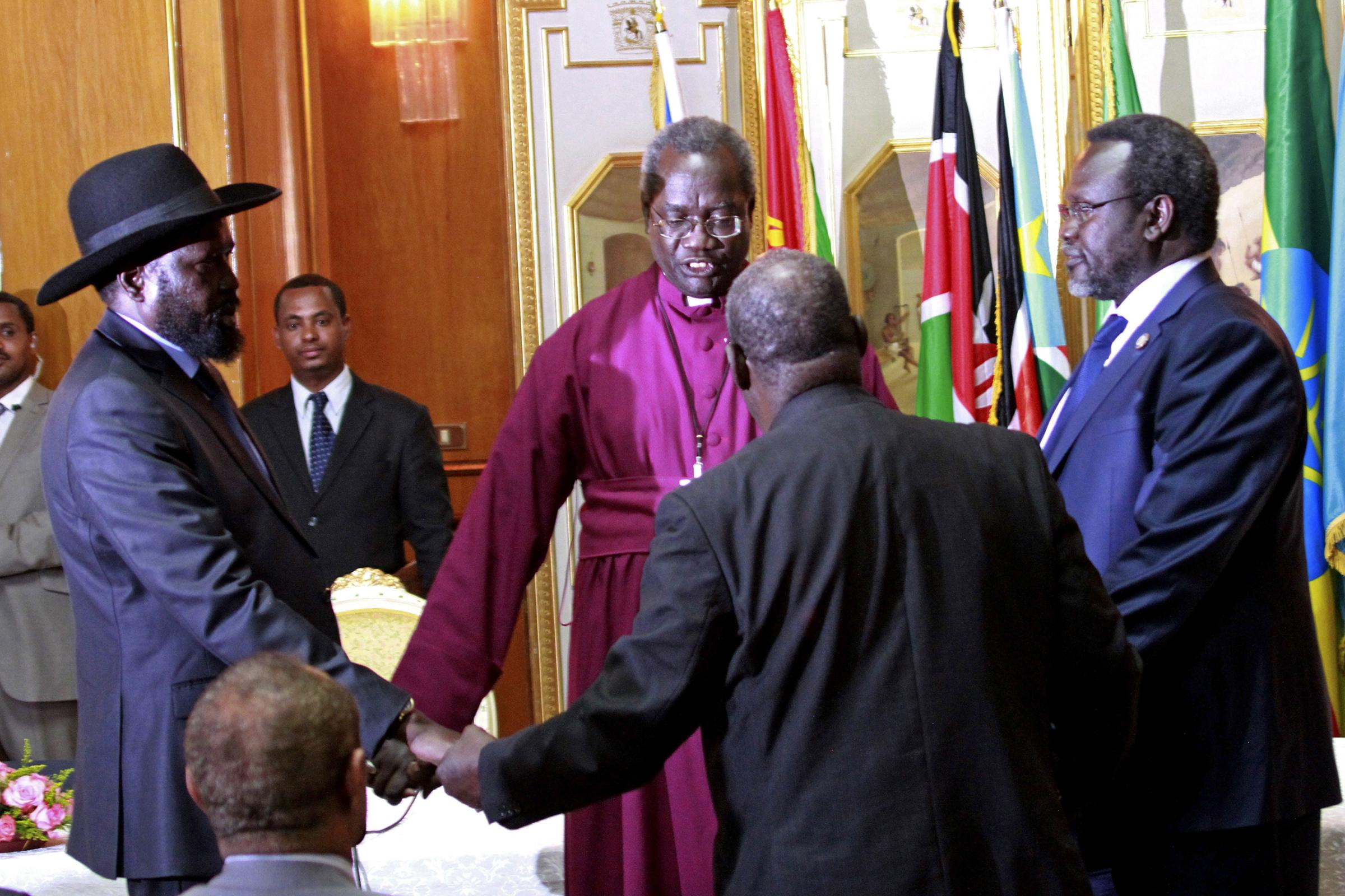 South sudanese leaders sign cease fire agreement kuow news and south sudans president salva kiir left and rebel leader riek machar right platinumwayz