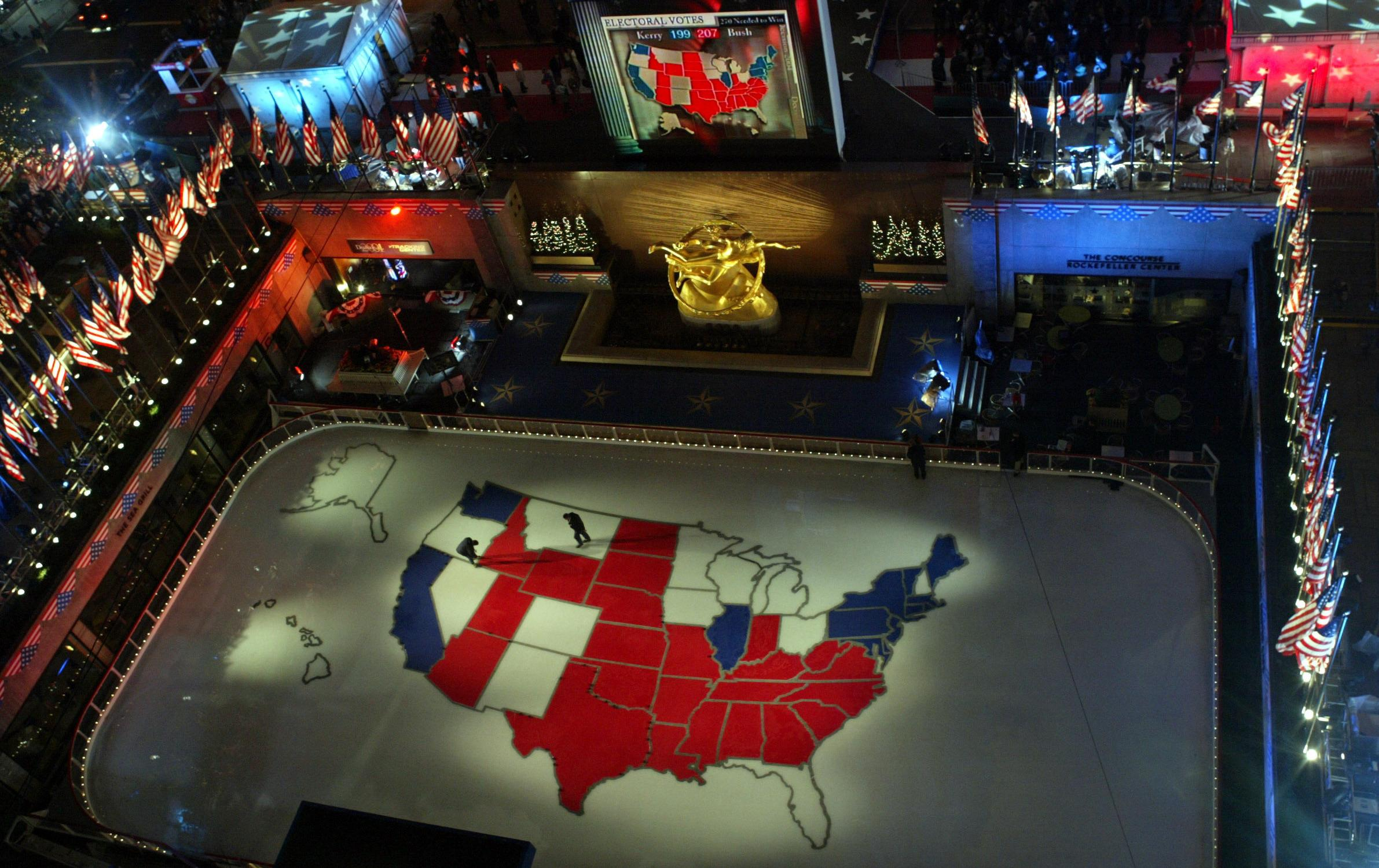 Workers Walk On A Giant Presidential Election Map Of The U S Made Of Ice In The