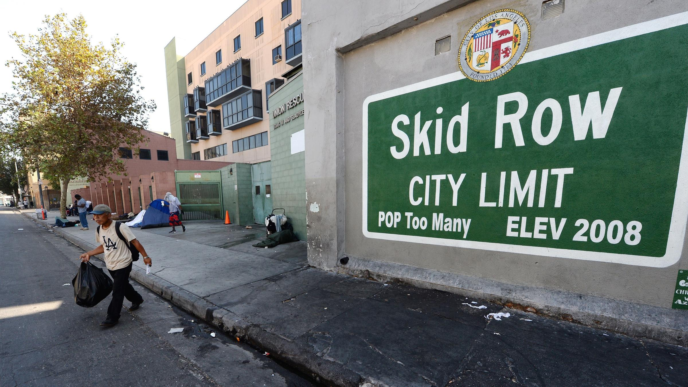As downtown la grows so does urgency to fix skid row for Homeless shelter in los angeles