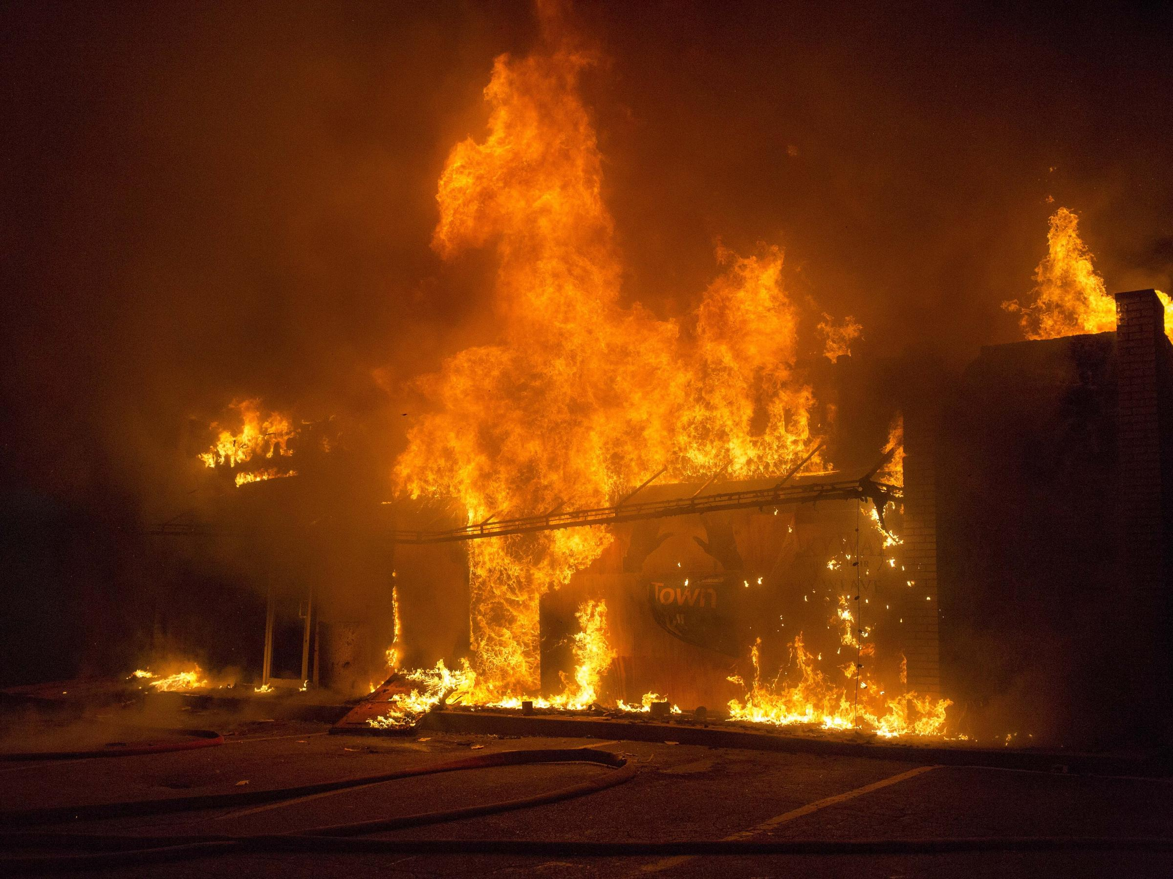 A business burns during the riots in Ferguson after the grand jury verdict