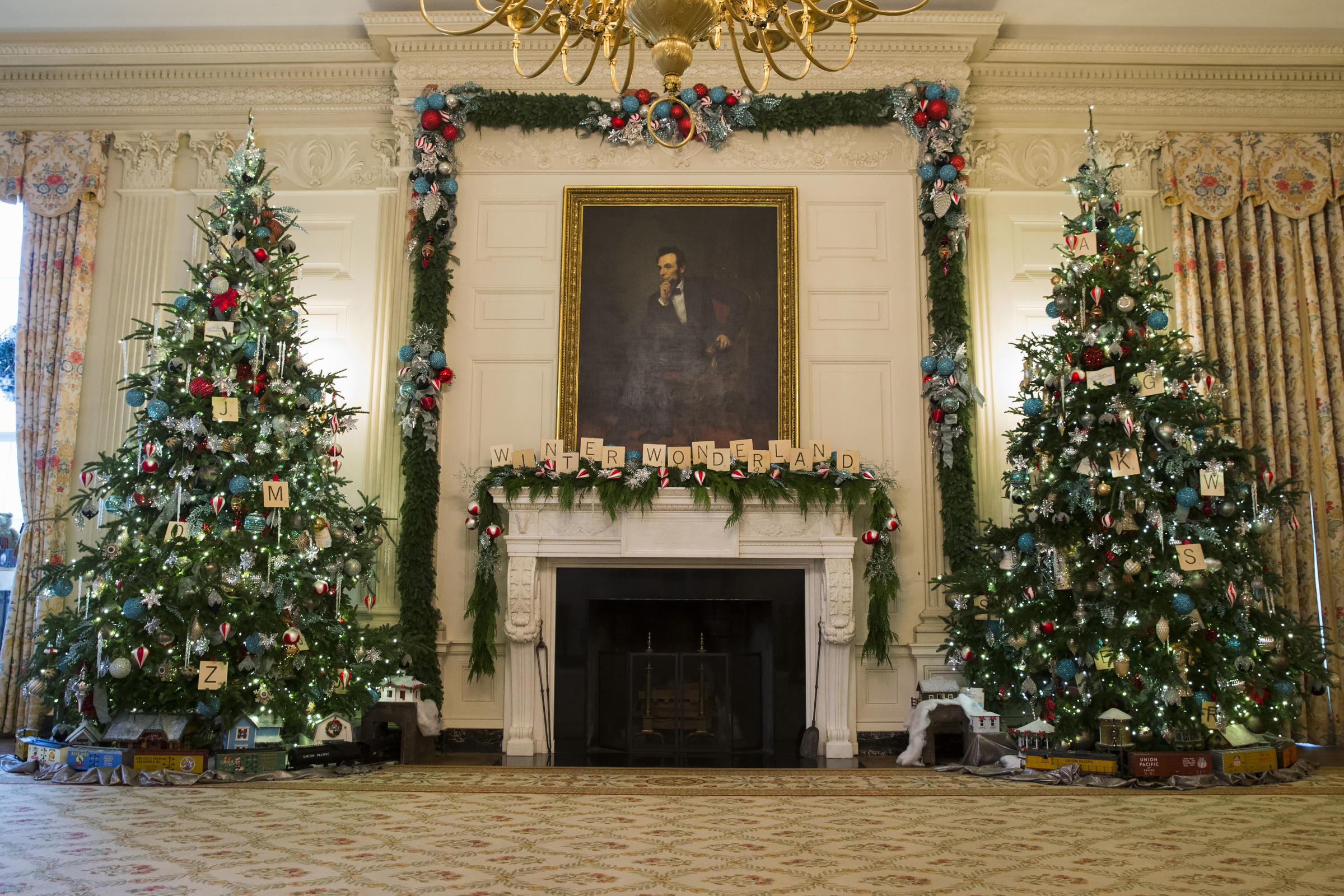 White house christmas ornaments by year - Christmas Trees Flank The Fireplace In The East Room Of The White House Every Year About 100 Volunteers Decorate The White House With Garlands