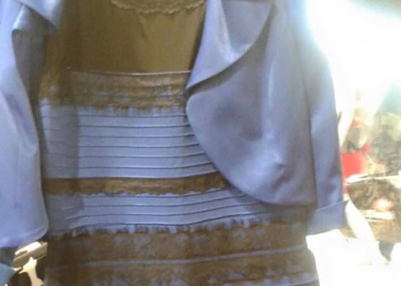 What color is the dress blue and black or white and gold