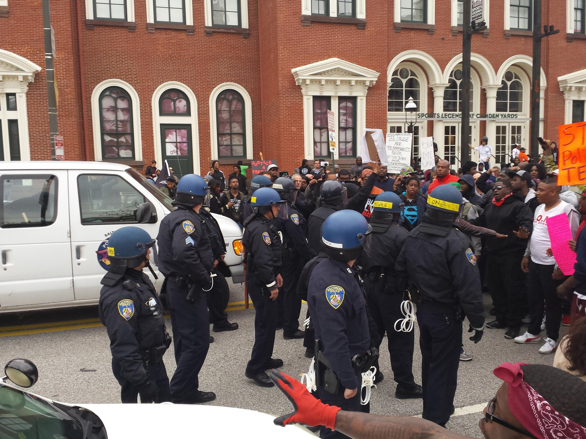 Baltimore police officers in riot gear push protestors back along - In Front Of The Sports Legends Museum Police Stood After An Exchange Between An Officer View Slideshow 6 Of 10