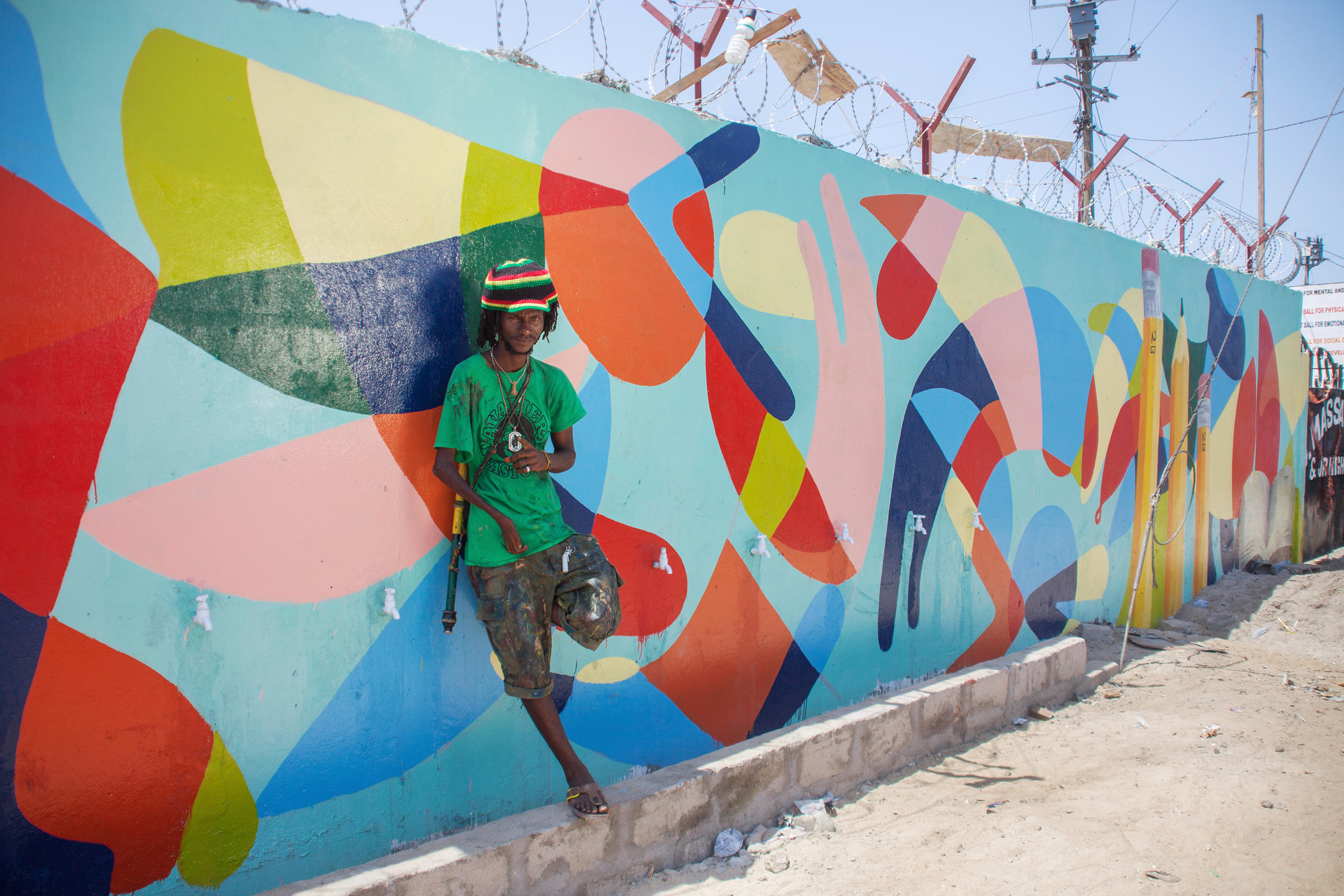 Baltimore artist helps turn liberian school into a mural for Abstract mural paintings