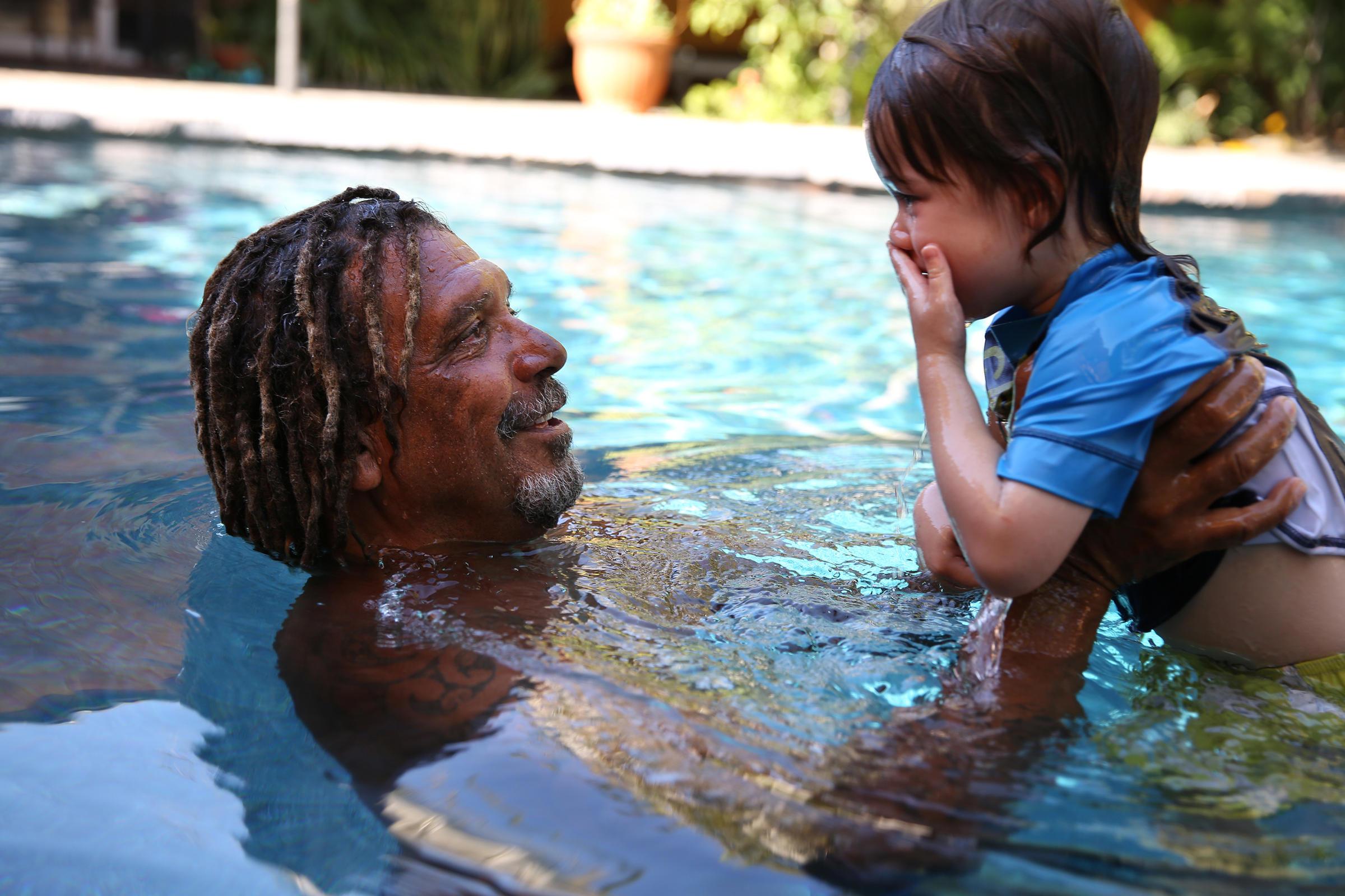 parents teaching kids how to swim