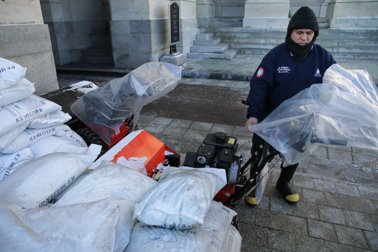 stone mason Medaro Romero covers gas powered snow sweepers in plastic ...
