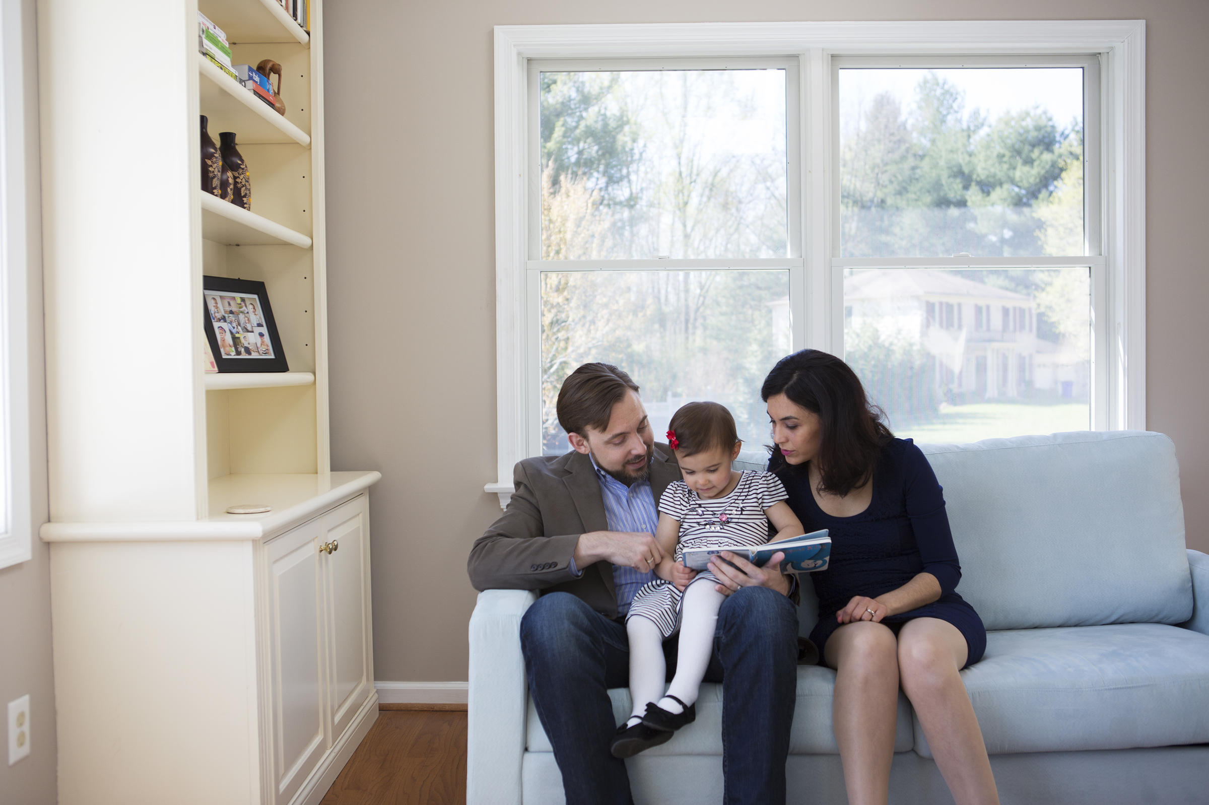 Travis And Sadiye Rieder Read A Book With Their 2yearold Daughter, View  Slideshow 3 Of 4