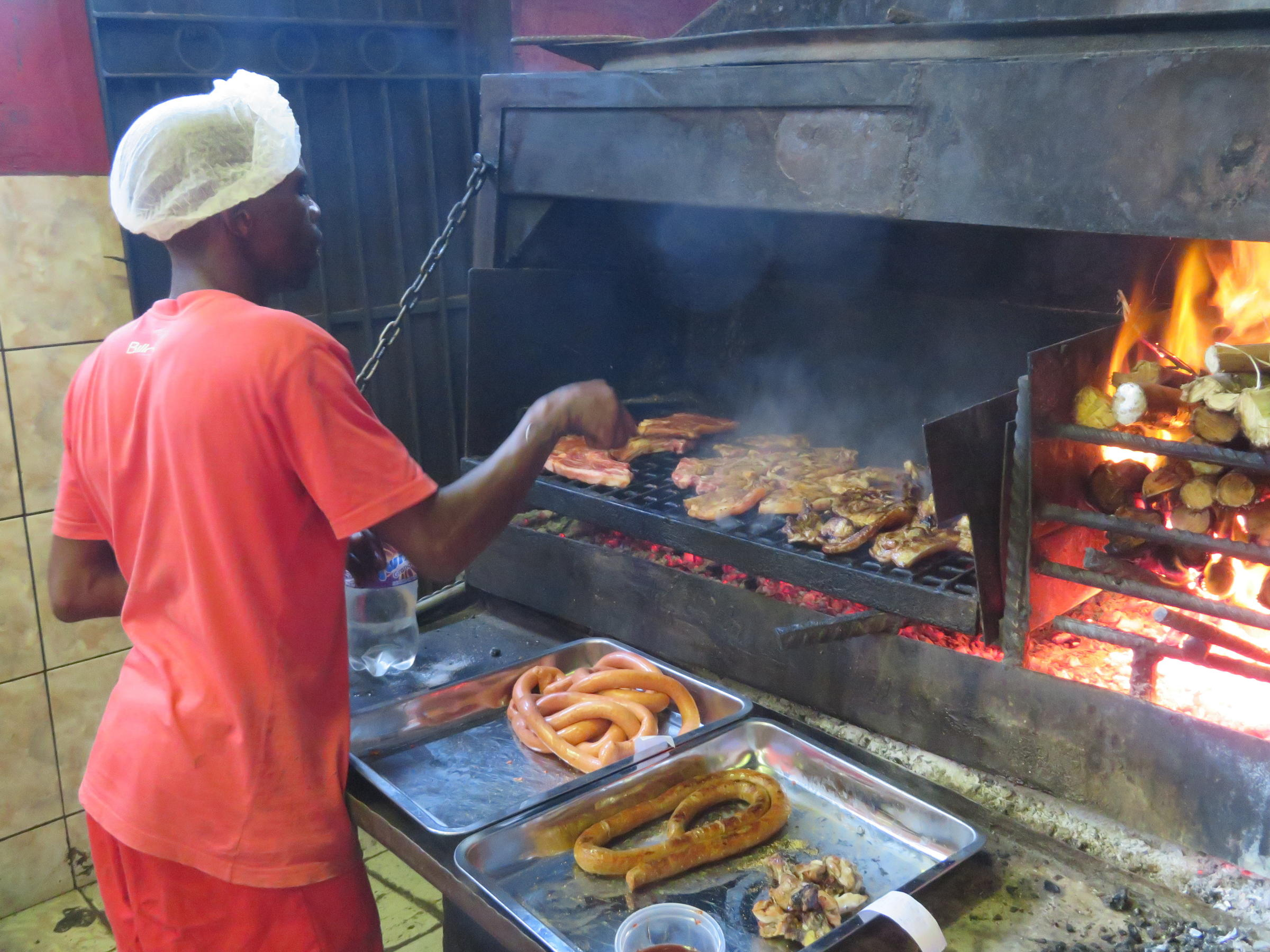 Braai Is South African For Barbecue Here Meat Roasted Over Wood At Mzolis A Popular Butcher And Grill In Gugulethu Township