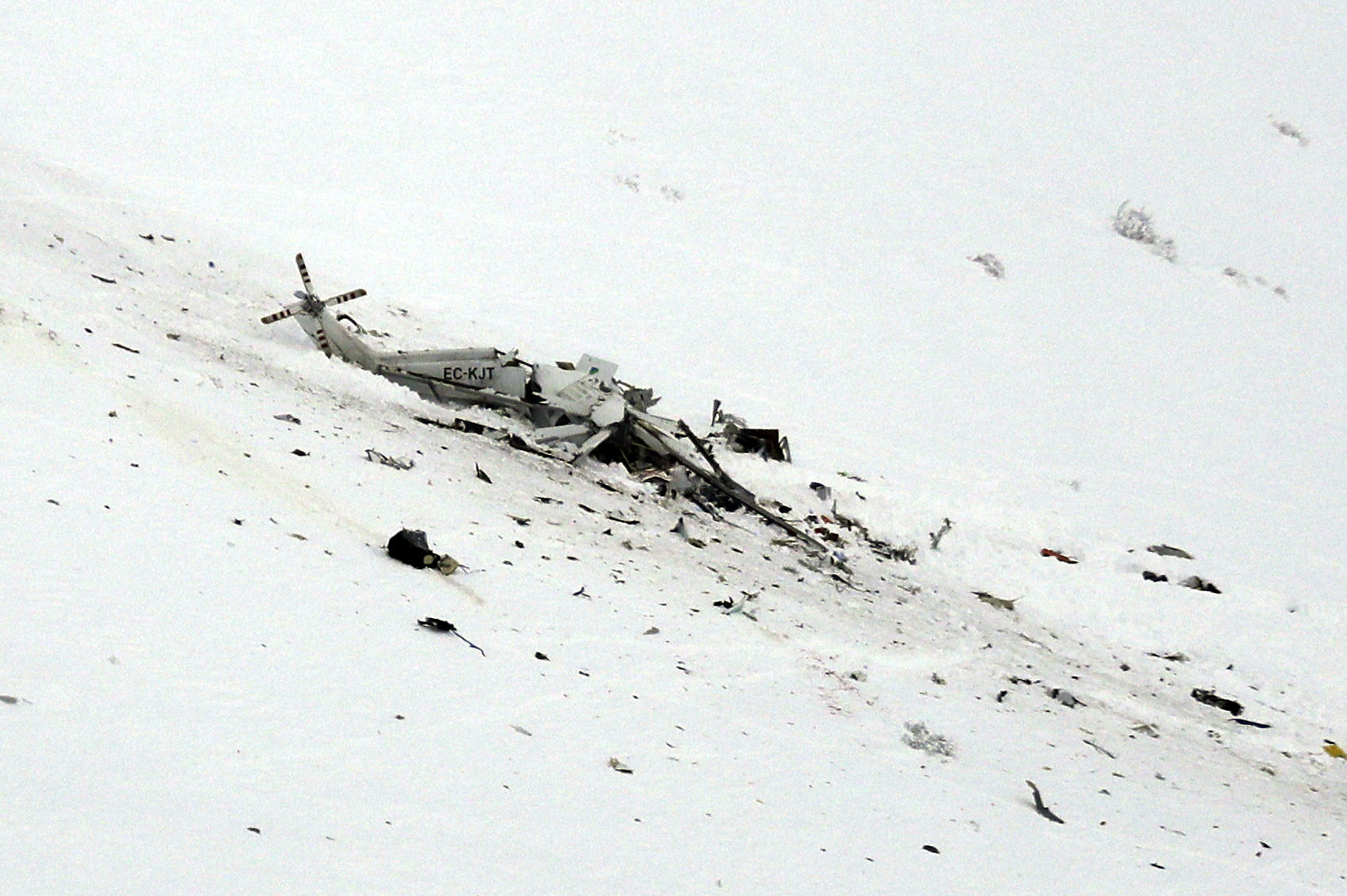 Rigopiano hotel avalanche first funerals as search goes on bbc news - The Wreckage Of A Helicopter Lies In The Snow After Crashing Tuesday In The Campo Felice Ski Area Of Central Italy