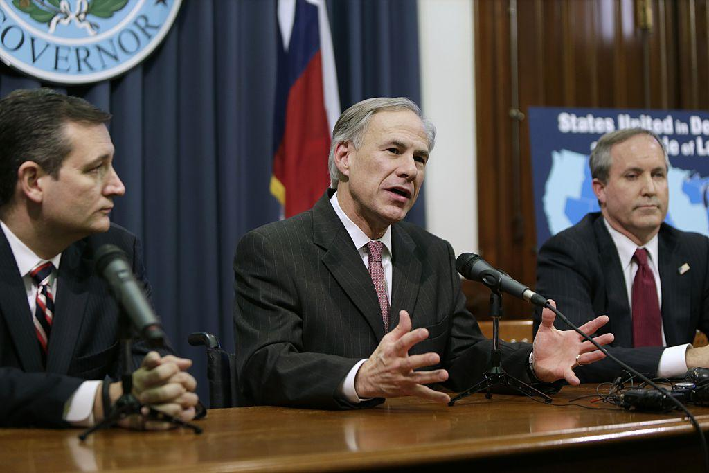 Texas Governor Greg Abbott speaks alongside U.S. Sen. Ted Cruz  and Attorney General Ken Paxton at a joint press conference Feb. 18 2015 in Austin Texas