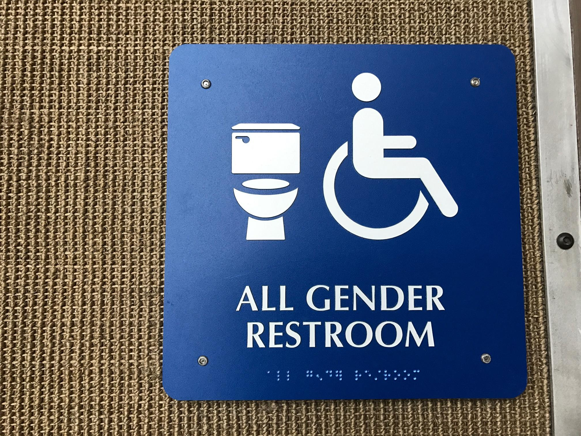Gender Neutral Bathroom Sign At The Austin Bergstrom Airport In