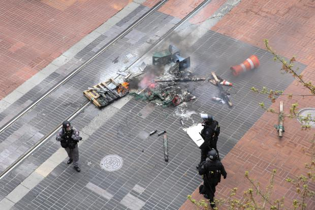 Man arrested for throwing flares during May Day riot