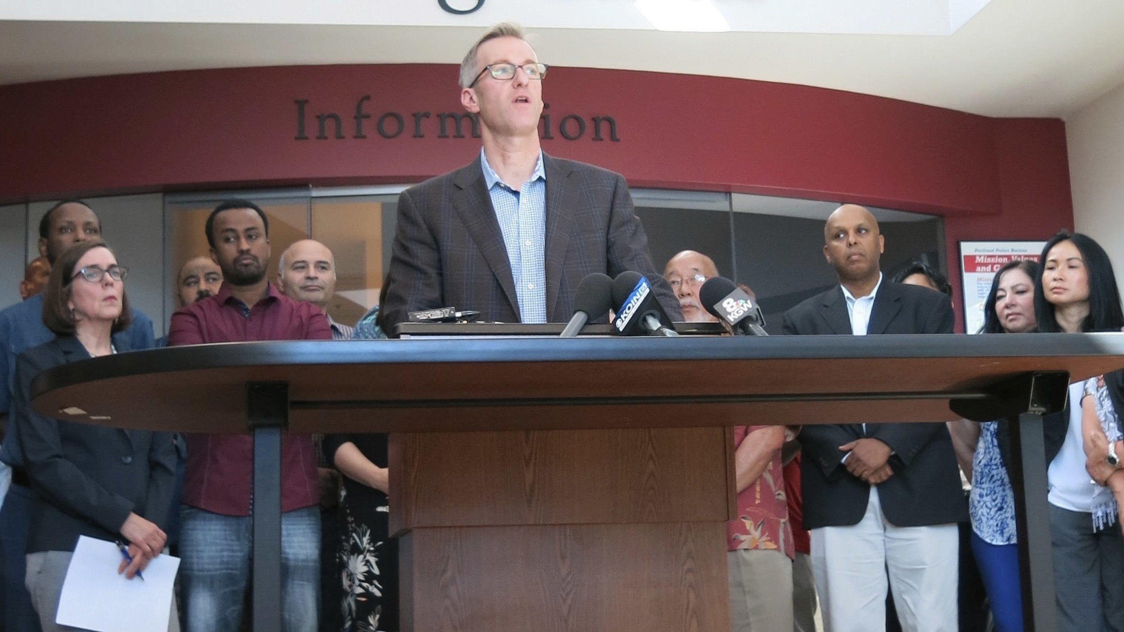 Portland Mayor Ted Wheeler speaks at a news conference in Portland on Saturday after a man fatally stabbed two men Friday on a light-rail train when they apparently tried to stop him from yelling anti Muslim slurs at two young women. Wheeler has since