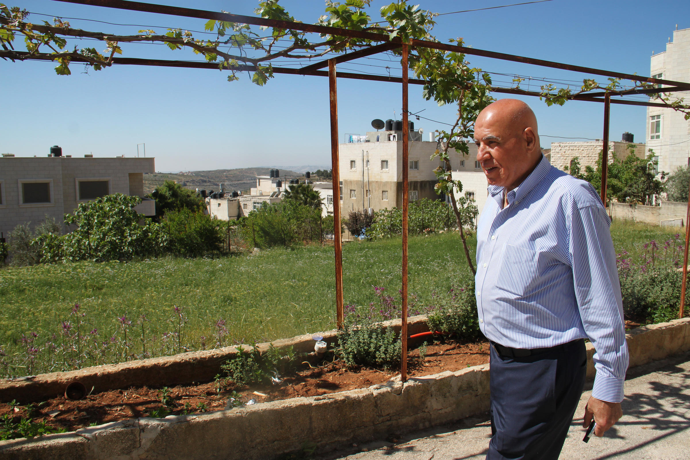 Omar Omar outside his family's home in the village of Deir Jarir. After living in the U.S. for decades he sees the West Bank with the eyes of an outsider