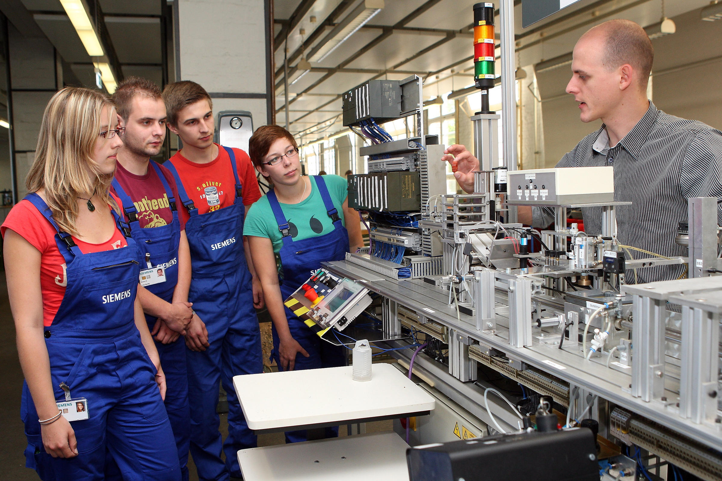 An Instructor At The Siemens Training Center In Berlin Germany With Apprentices In Germany Apprenticeship Training Is Much More Common Than In The United