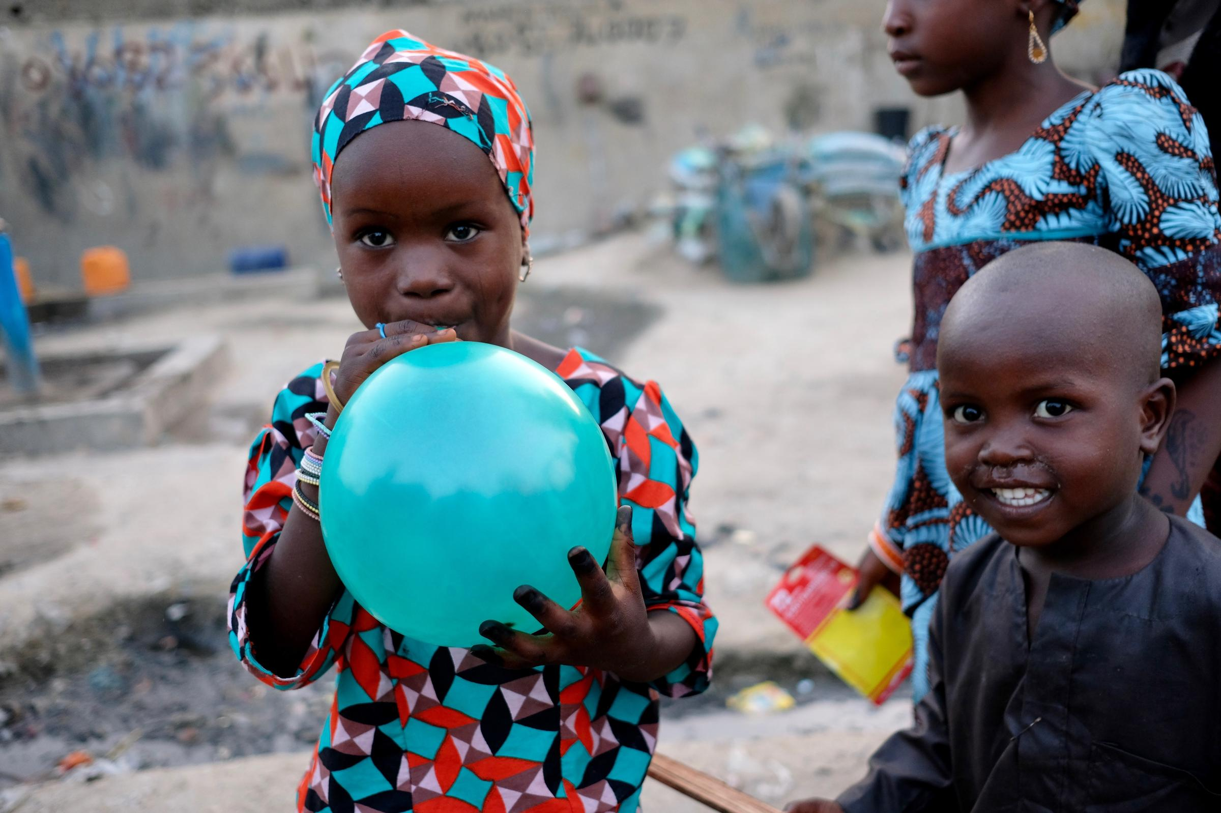 In northeast nigeria displaced families celebrate ramadans end five year old fatima shows off her sallah gift in a camp for those internally displaced by the ongoing violence in maiduguri the capital of borno state in kristyandbryce Images