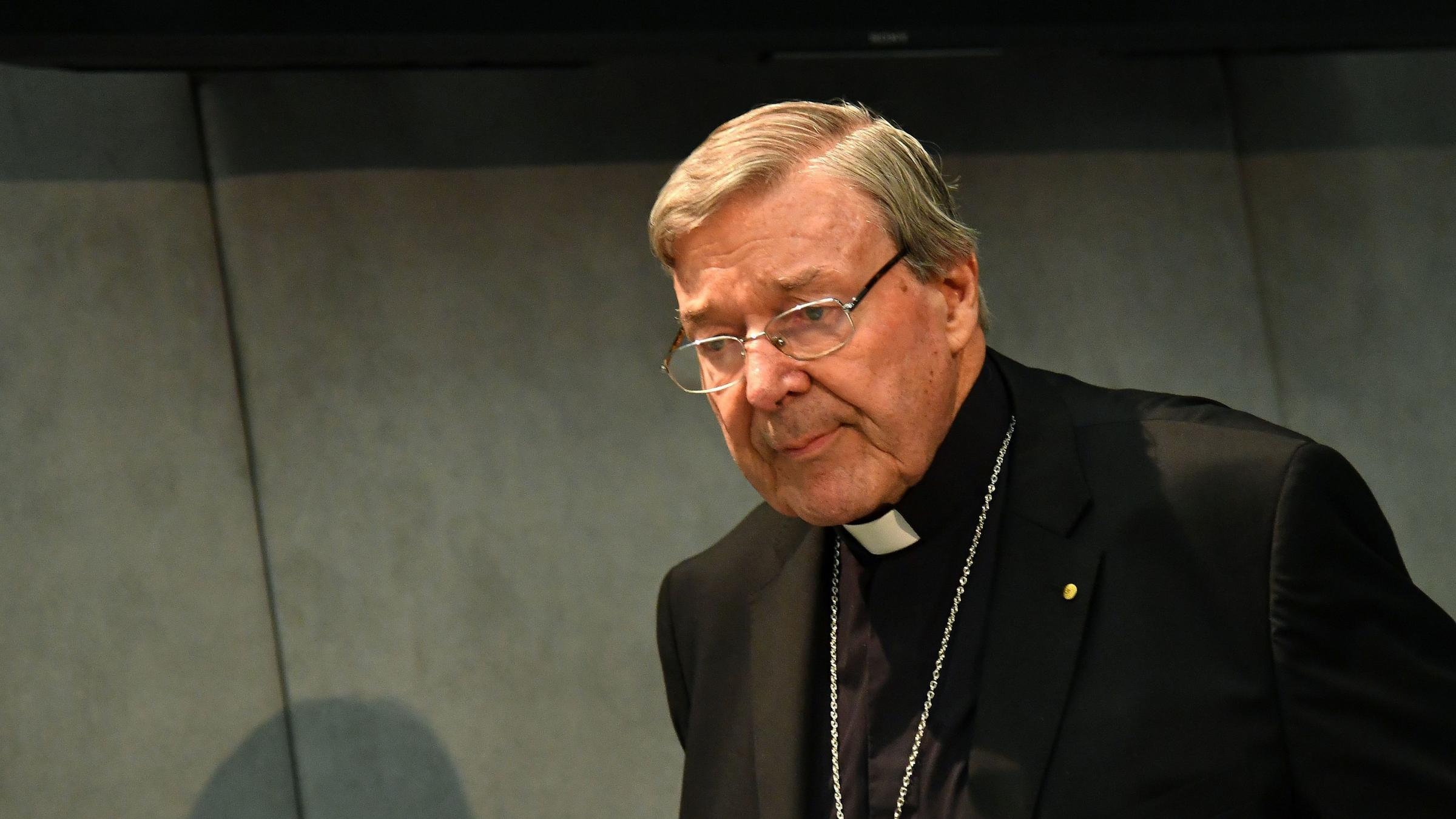 Australian Cardinal George Pell looks on as he makes a statement at the Holy See Press Office in Vatican City on June 29 after being charged with historical sex offenses. Pell has since returned to Australia to face the charges which he denies