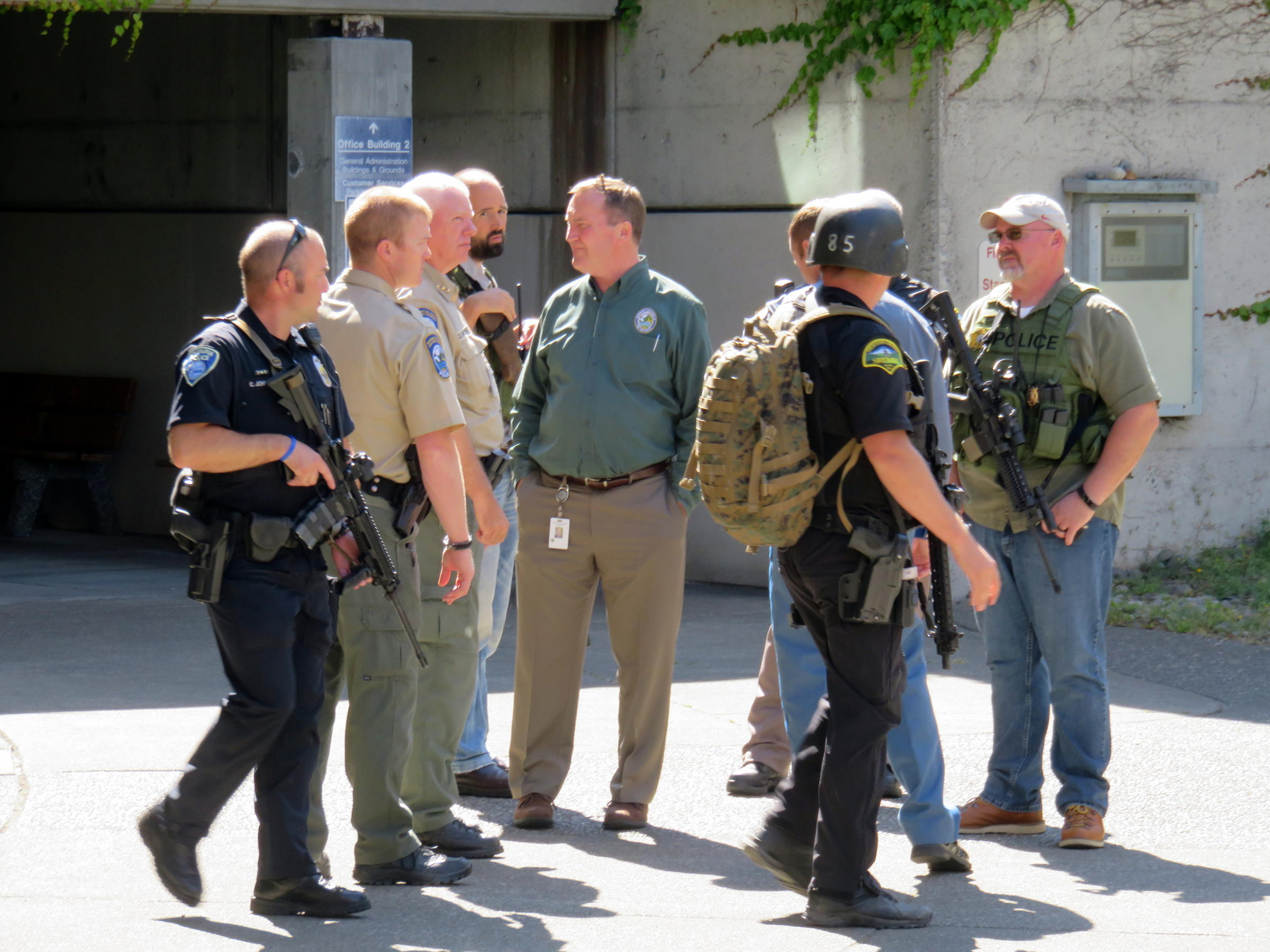 Heavily armed officers swarmed the Washington State Capitol Campus on Wednesday after an unconfirmed report of gunshots