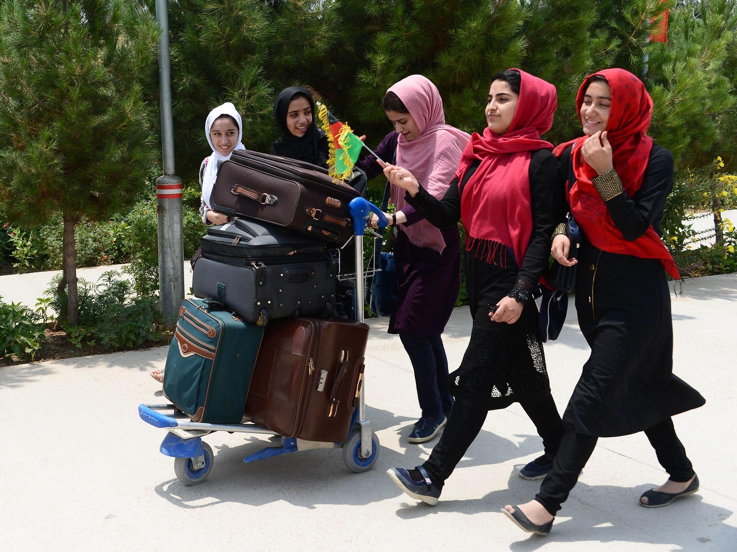The team walks towards Herat International Airport on Thursday