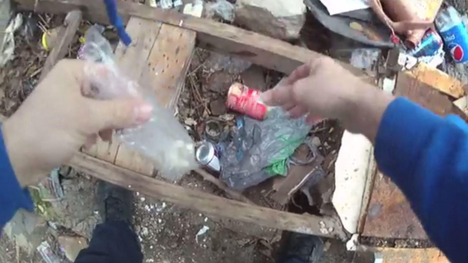 Body camera footage shows officer planting drugs, public defender says