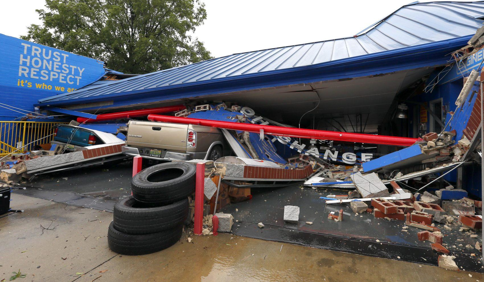 Cars flipped and trees split in wake of possible tornado