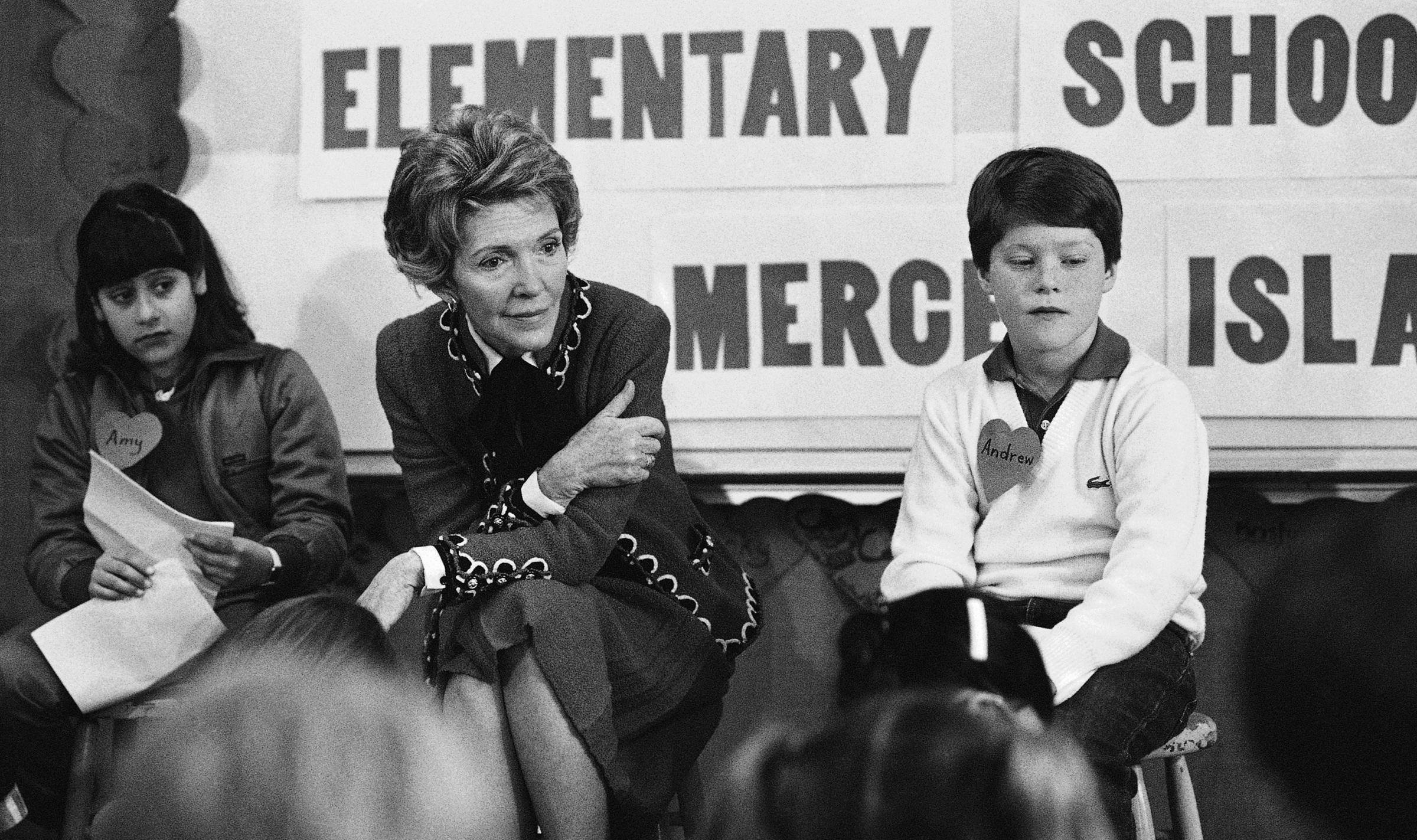 First lady Nancy Reagan sits with fourth and fifth-graders at Island Park Elementary School on Mercer Island Wash. where she participated in a drug education class in 1984
