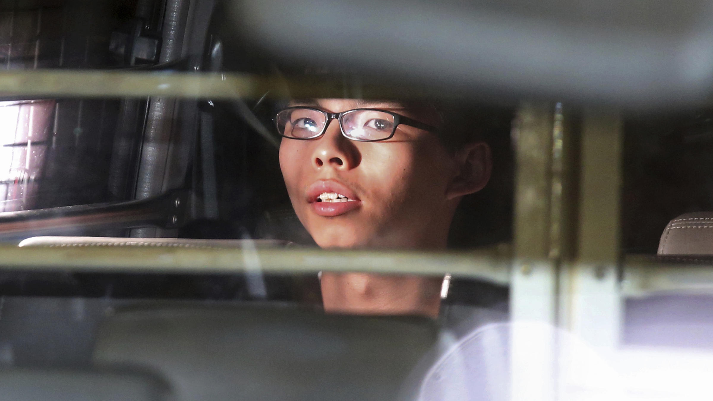 Joshua Wong seen in the prison bus after his sentencing in Hong Kong on Thursday