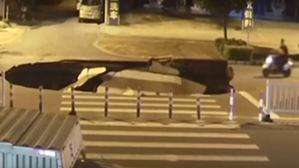 Caught on Camera: Distracted Rider Rolls Into Sinkhole