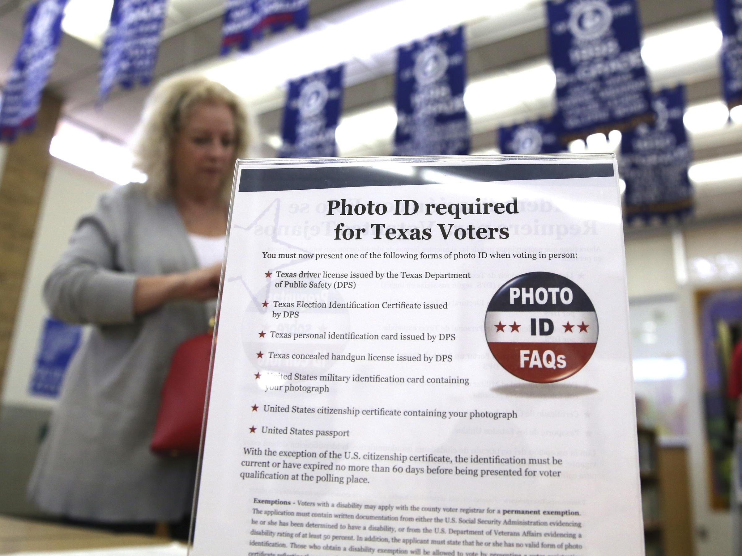 Federal judge strikes down Texas' voter ID law