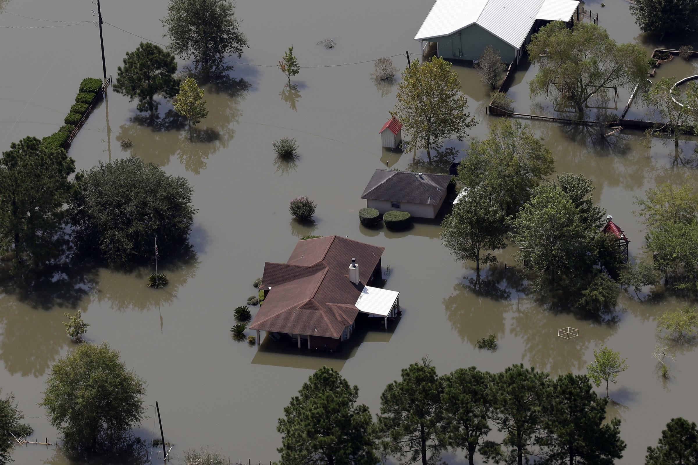 Homes are surrounded by floodwaters in the aftermath of Hurricane Harvey near Beaumont Texas on Friday