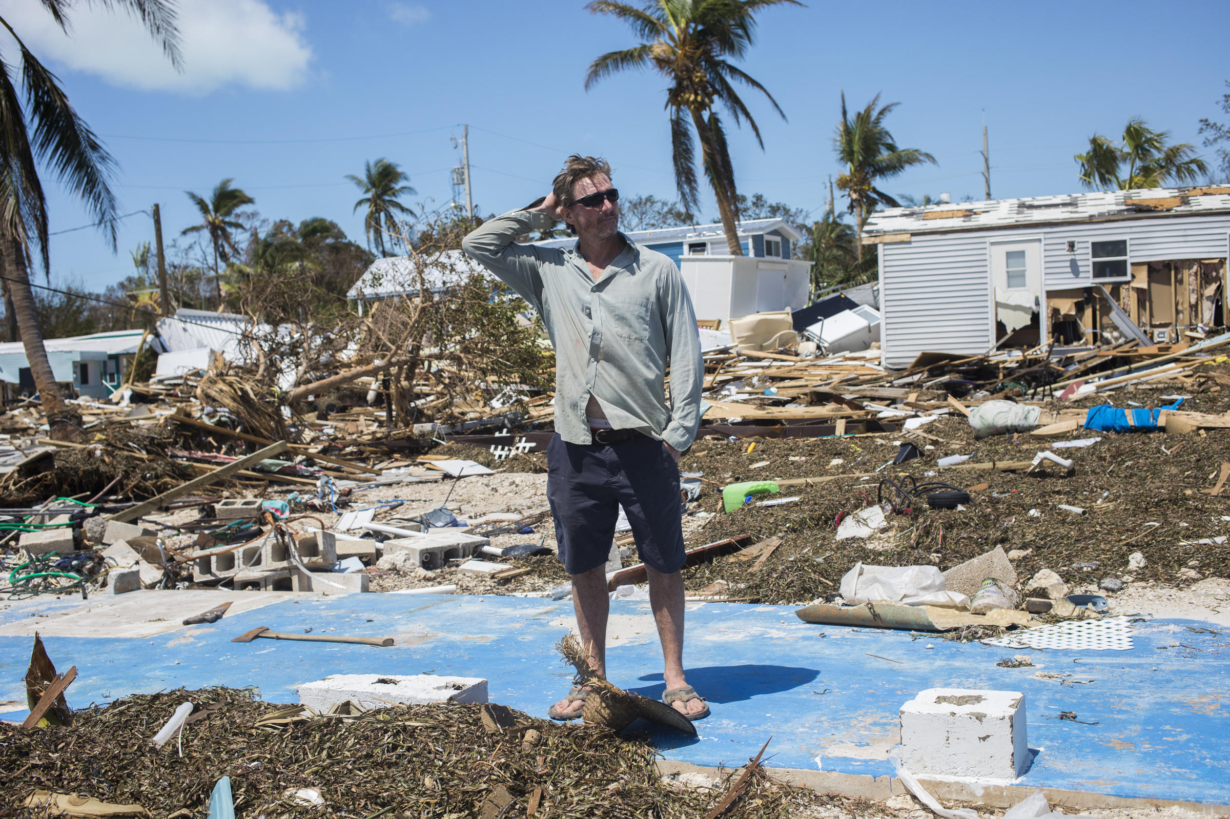 Bill Quinn stands where his home once sat in Sea Breeze Mobile Home Community on Tuesday. The home was passed down three generations and had an ocean view