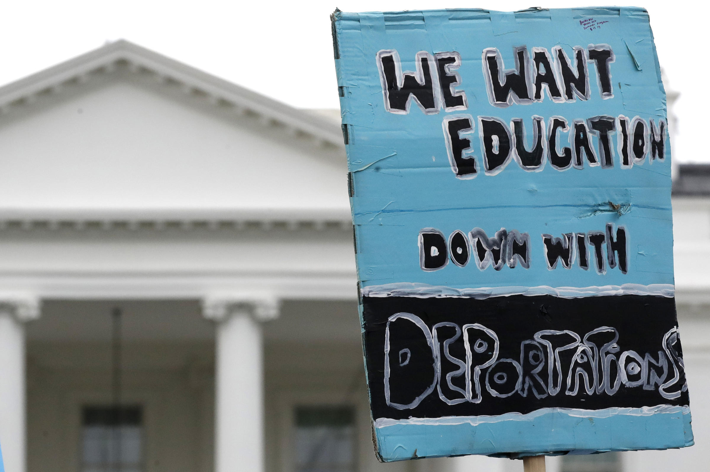 A sign is held up by the White House in support of the DREAMers and the Deferred Action for Childhood Arrivals program on Sept. 5 when Attorney General Jeff Sessions announced the Trump administration will