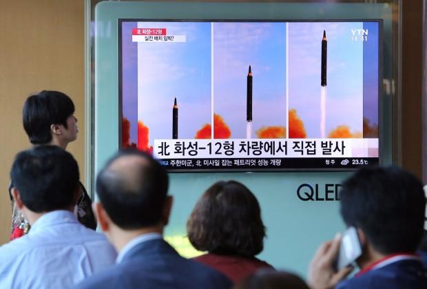 People watch a TV screen showing a local news program reporting about North Korea's missile launch at the Seoul Railway Station in Seoul South Korea Saturday Sept. 16 2017. The North Koreans have twice tested missiles theoretically able to hit