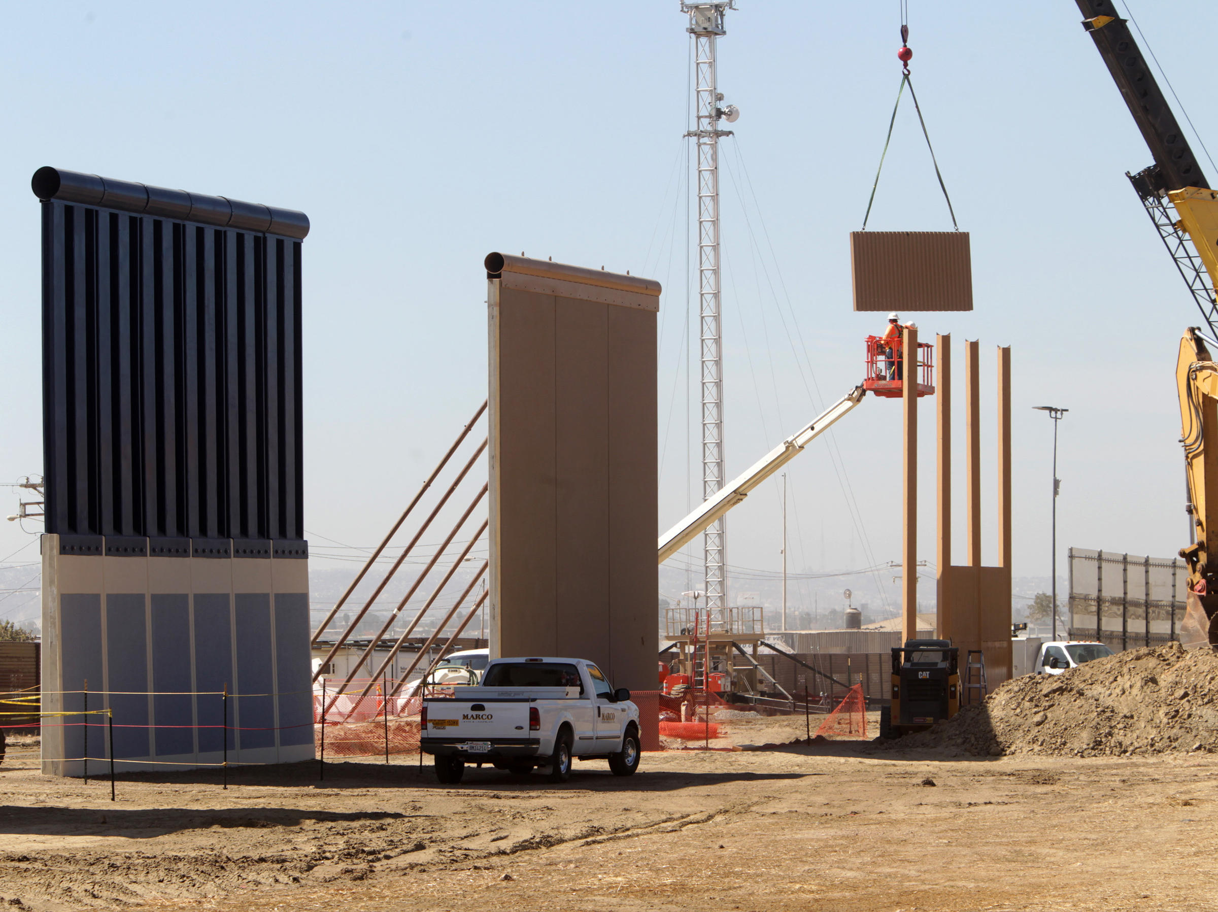 30 foot border wall prototypes erected in san diego for Builder contractors