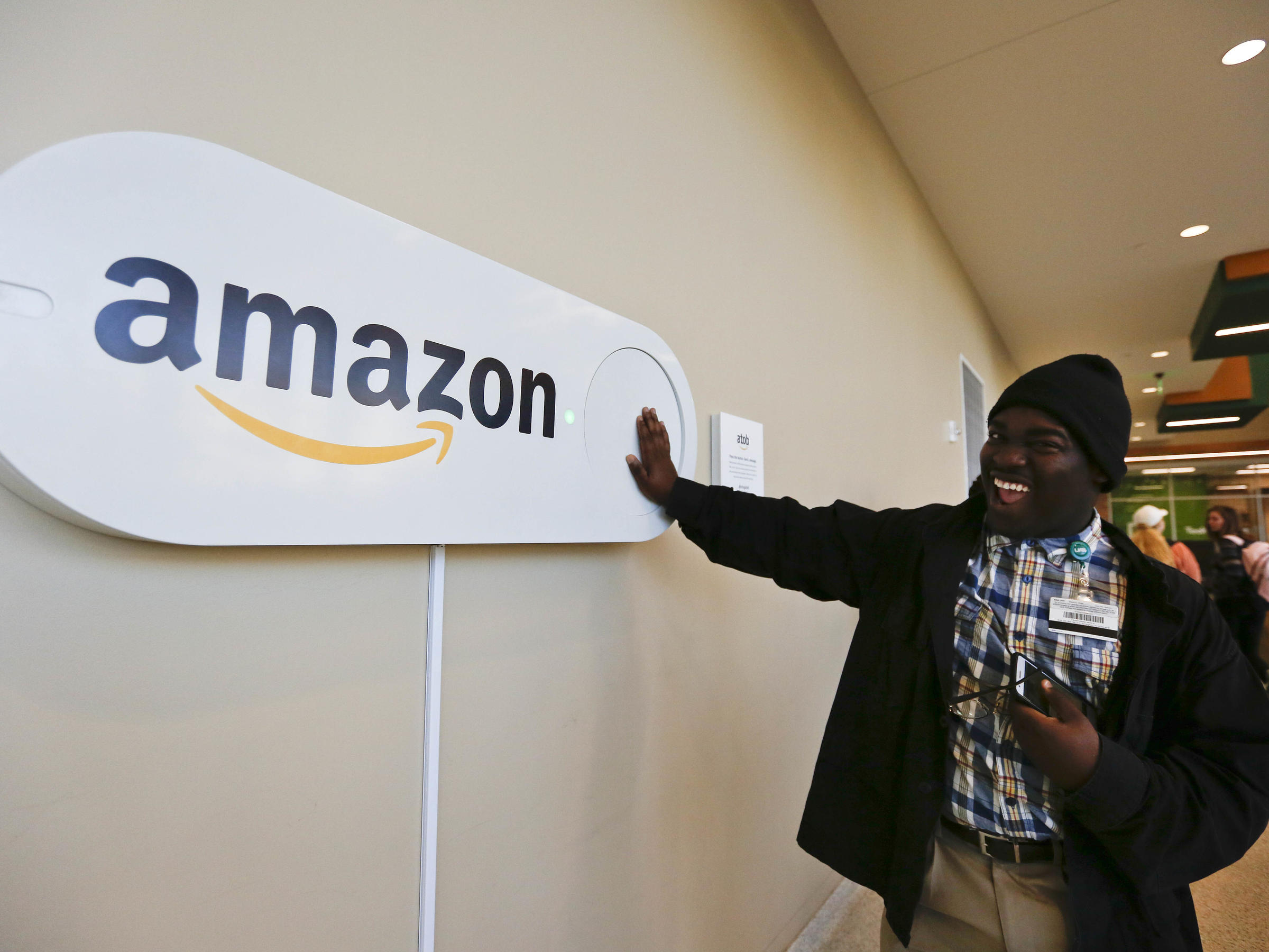 Zavian Tate a student at the University of Alabama at Birmingham pushes a large Amazon Dash button part of the campaign to lure Amazon's second headquarters to the city
