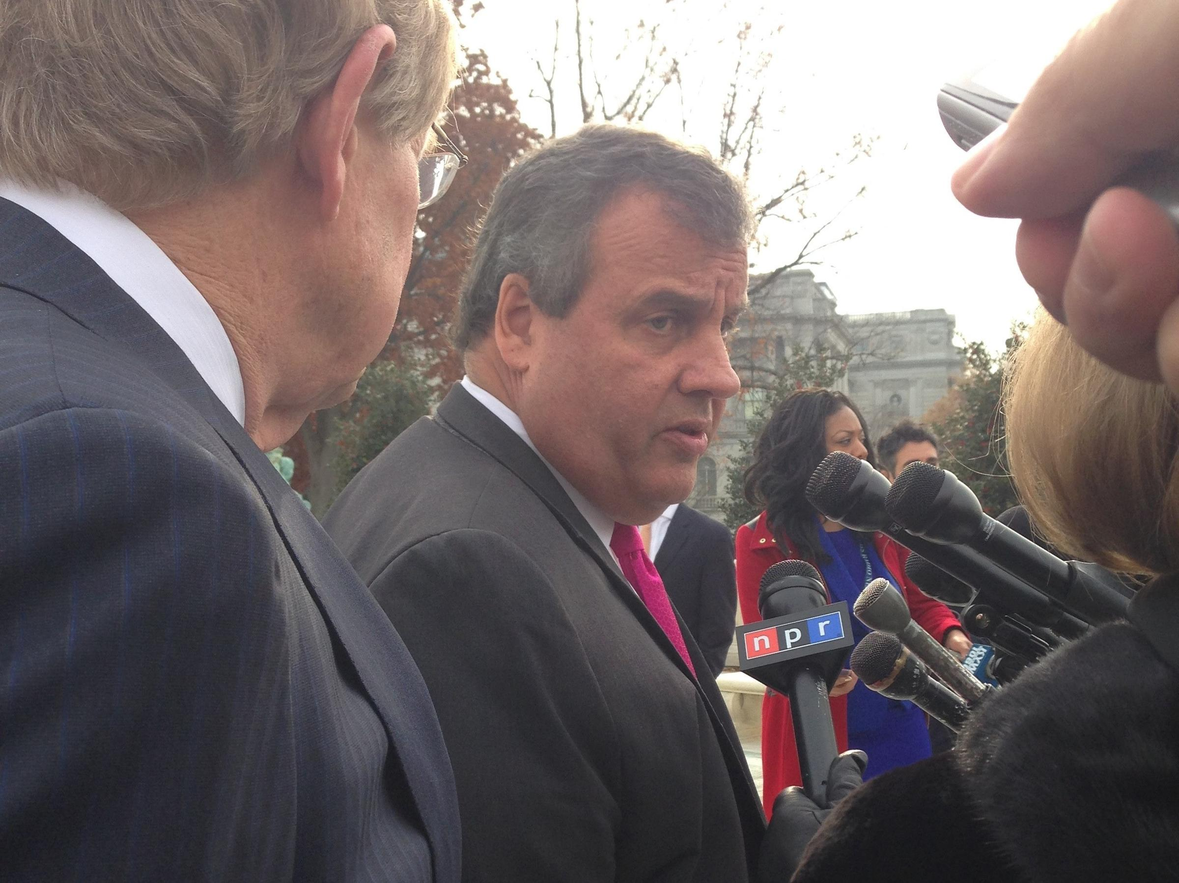 New Jersey Gov. Chris Christie answers questions about a sports gambling case after Supreme Court arguments on Monday
